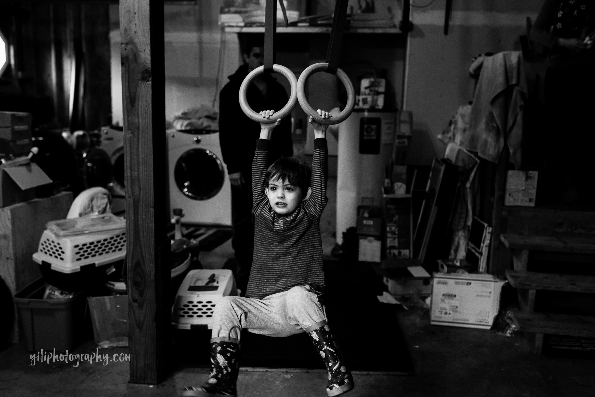seattle toddler swinging on gymnastics rings