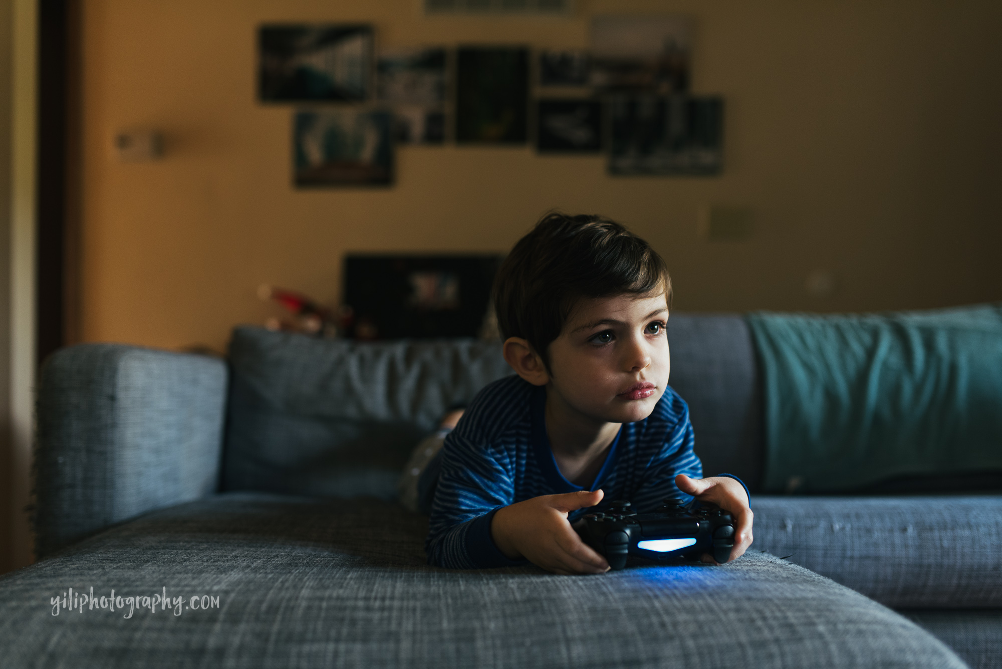 seattle toddler holding video game controller