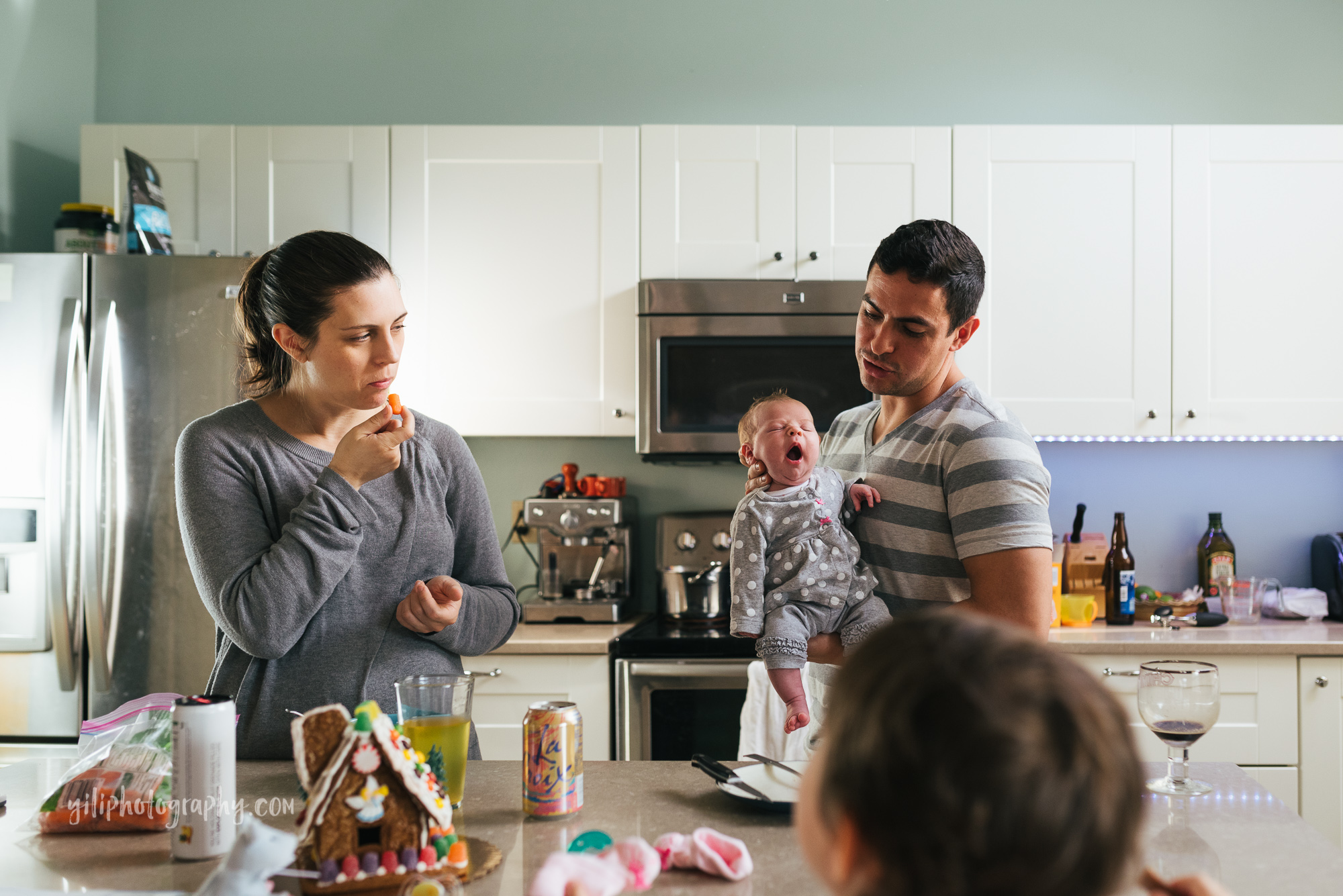 seattle family eating together in kitchen with newborn baby