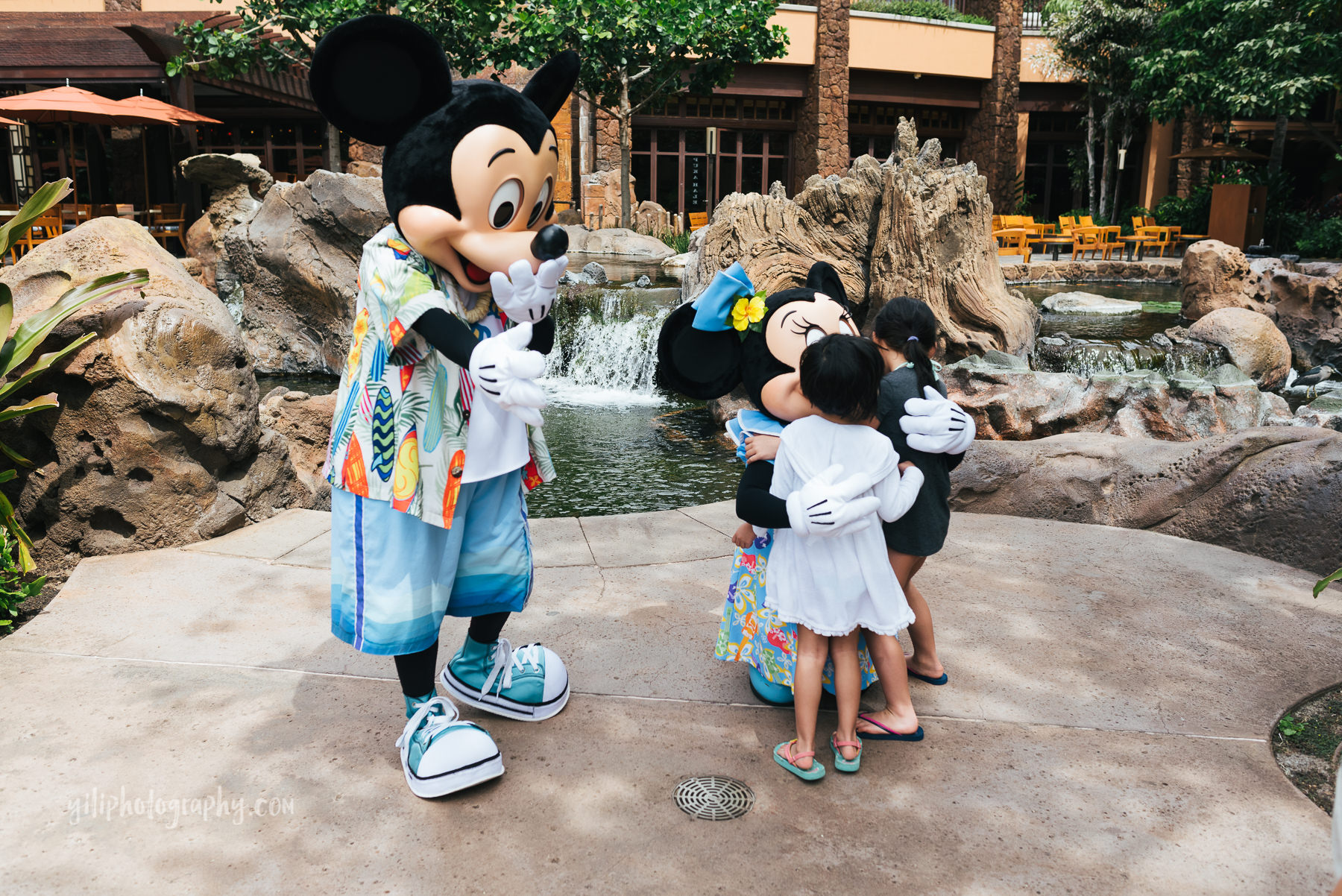 girls meeting disney characters at aulani