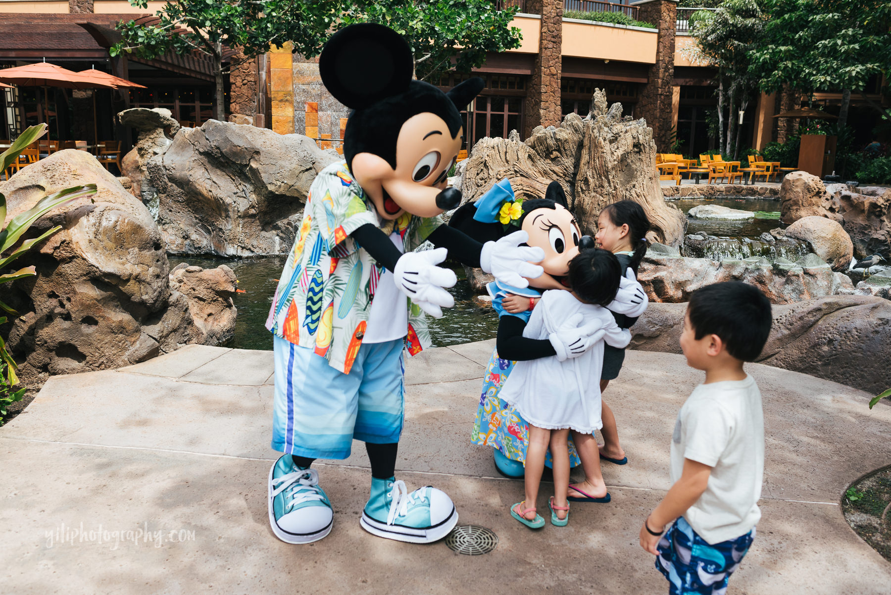 little boy meets mickey mouse at aulani
