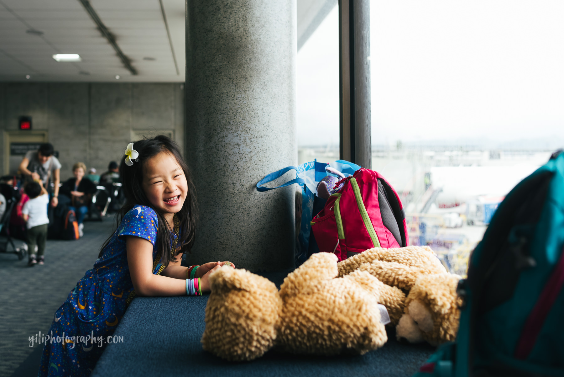 girl smiling at airport