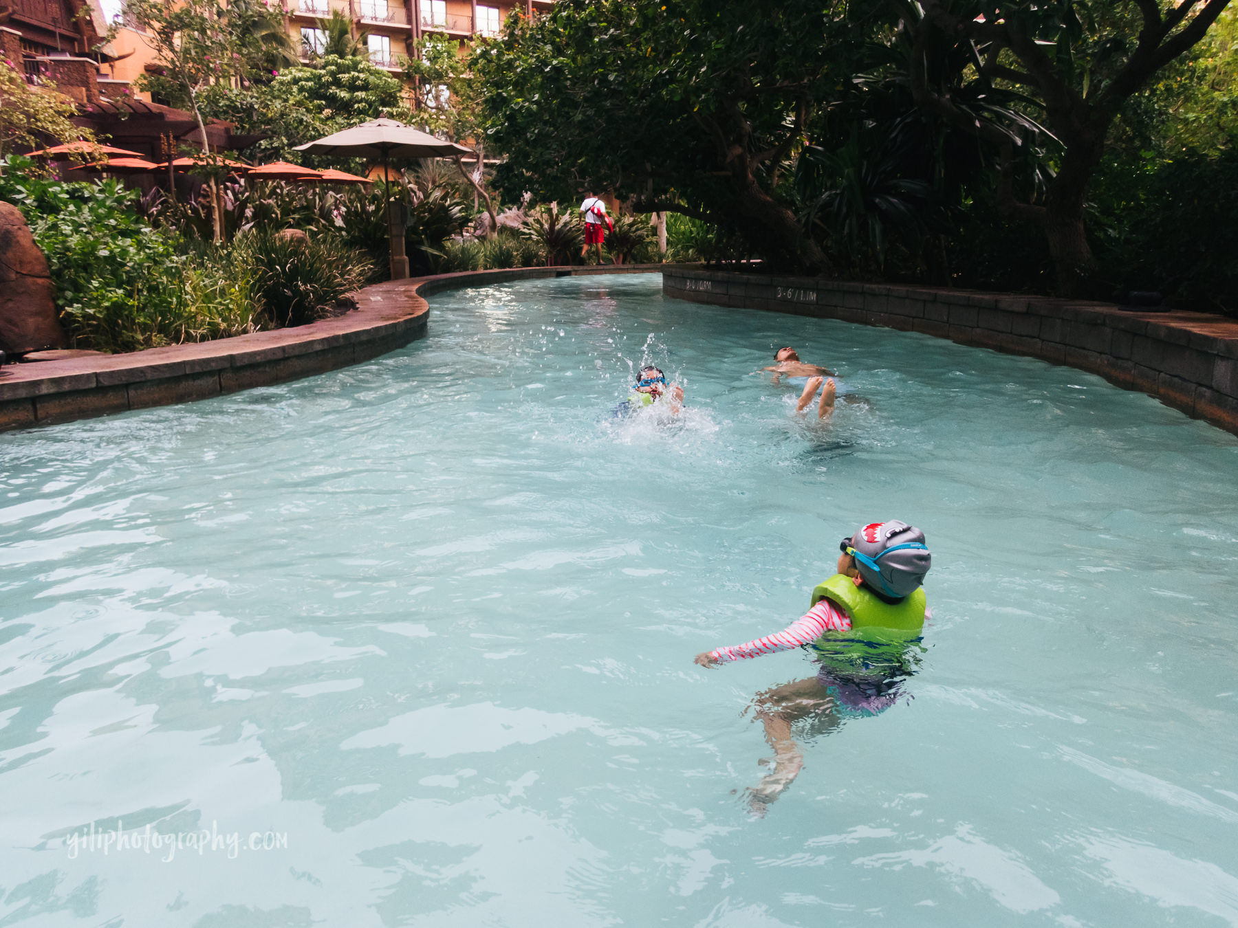 family floating down lazy river at Aulani