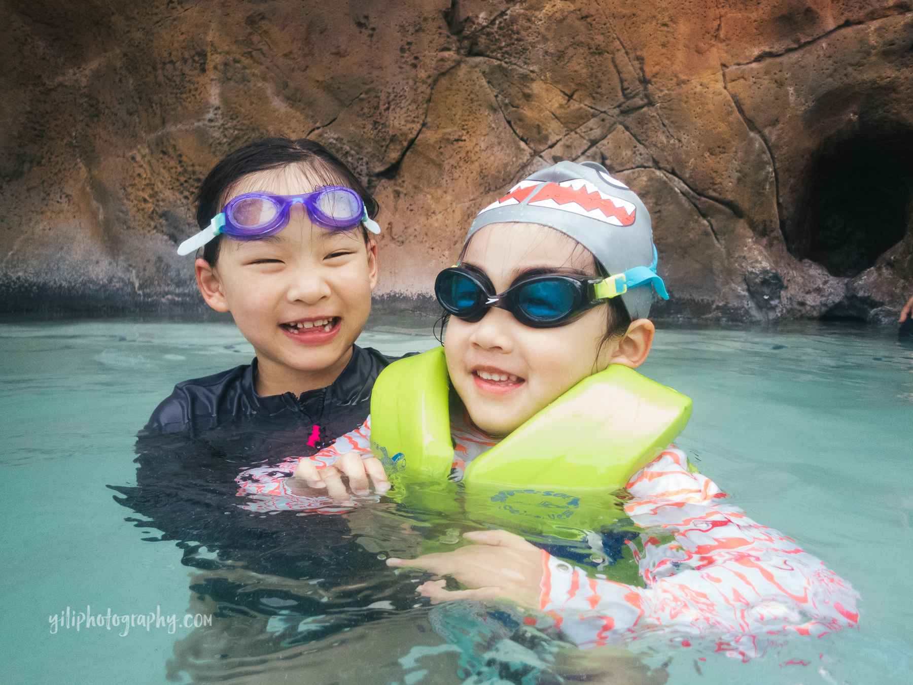 sisters wearing goggles in pool together