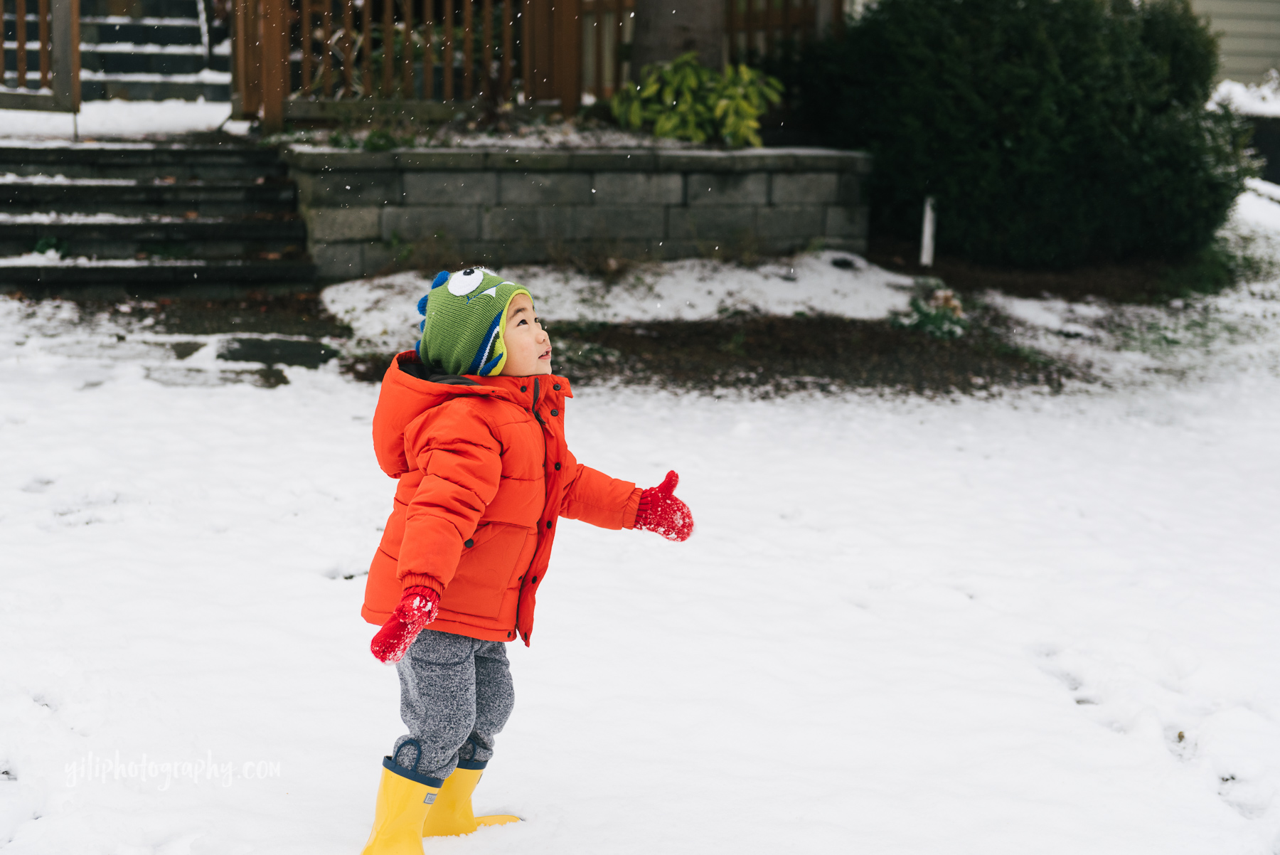 little boy throwing snow in seattle