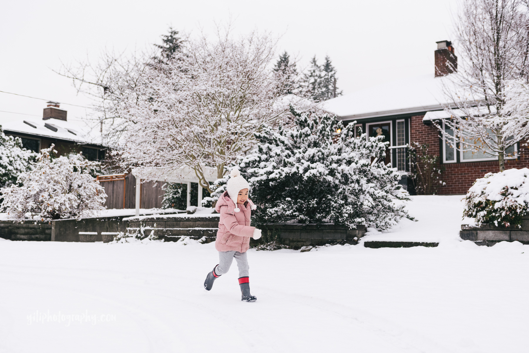 little girl running in snow seattle