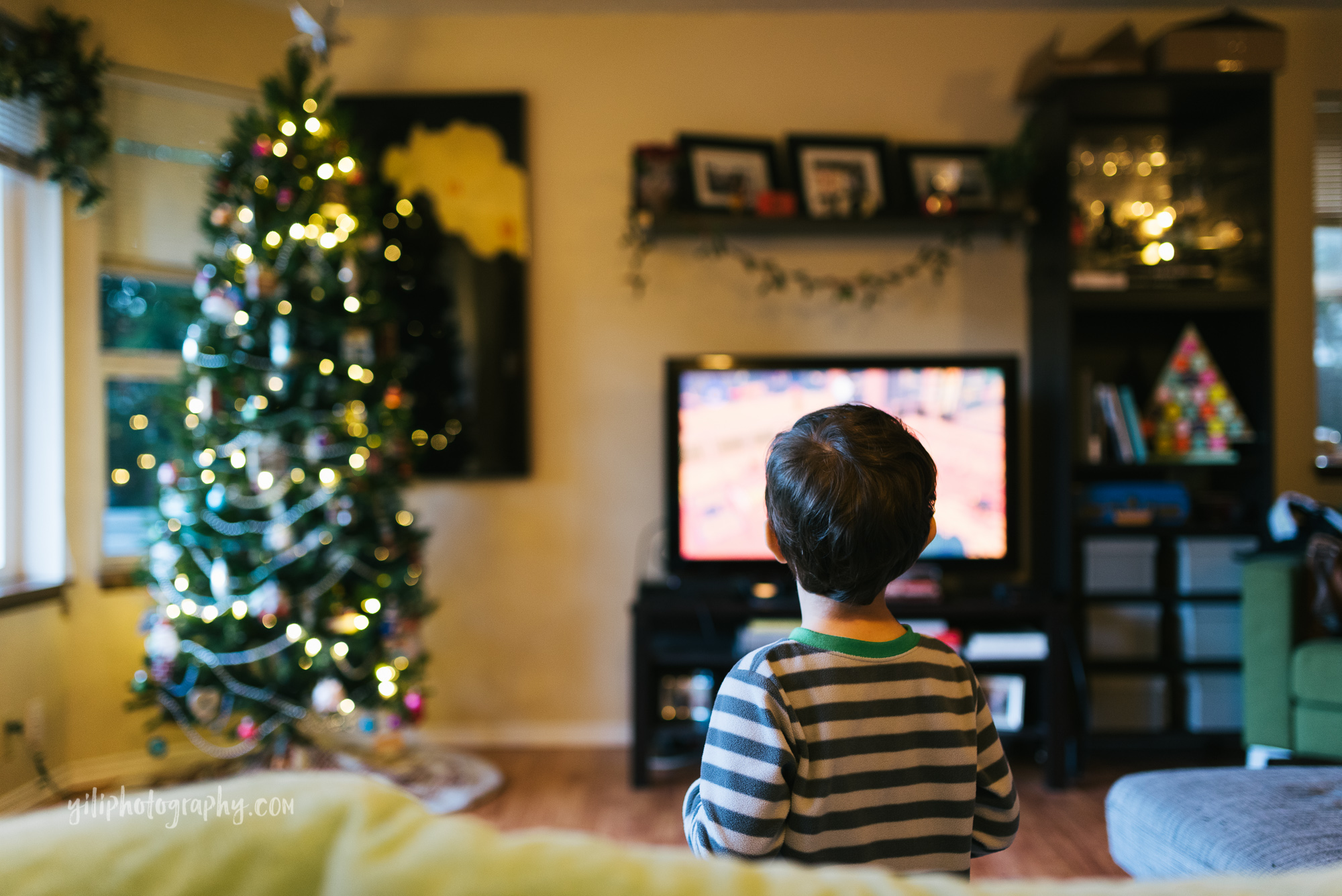 Seattle little boy looking at video game on television
