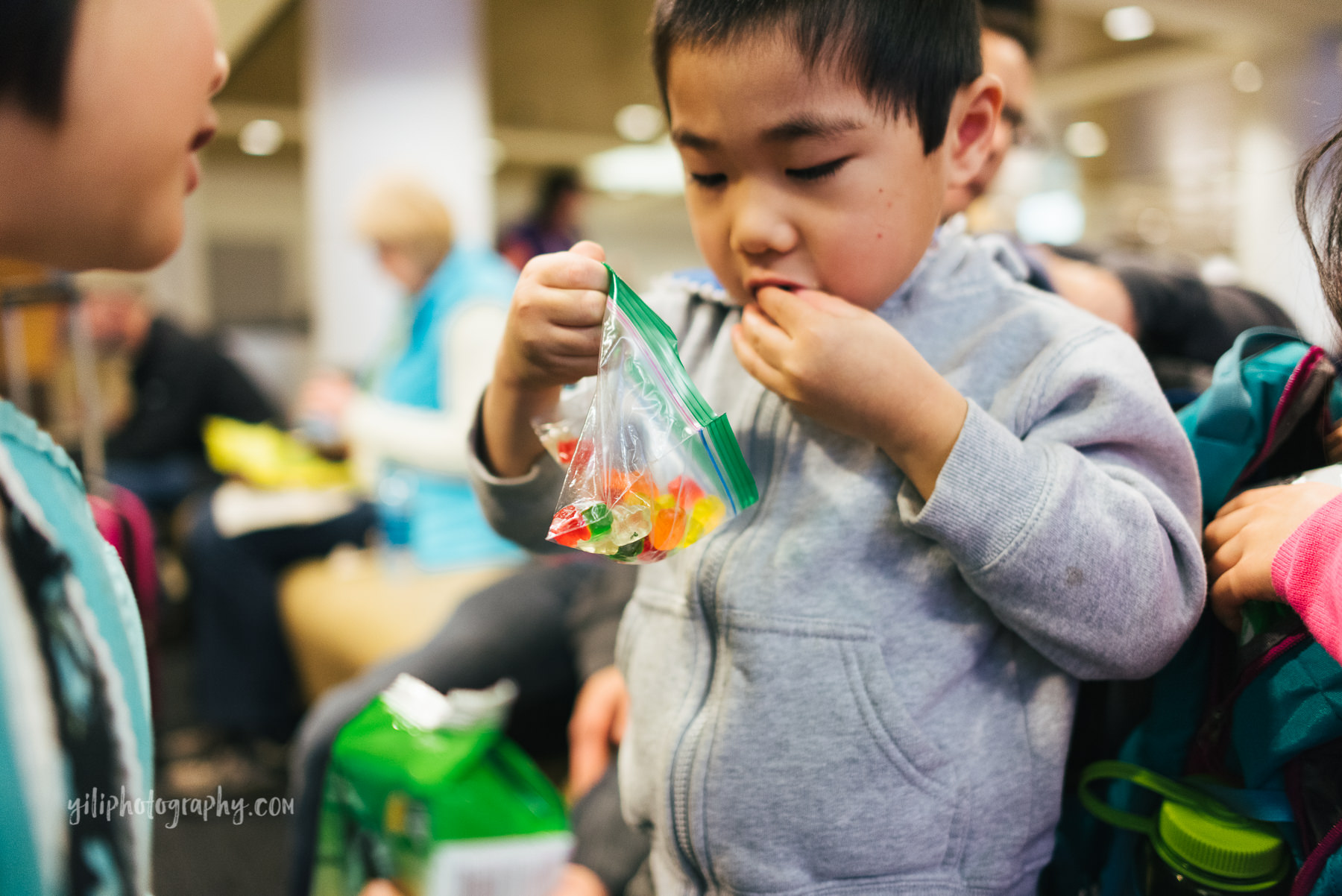 little boy looking in bag of gummy bears