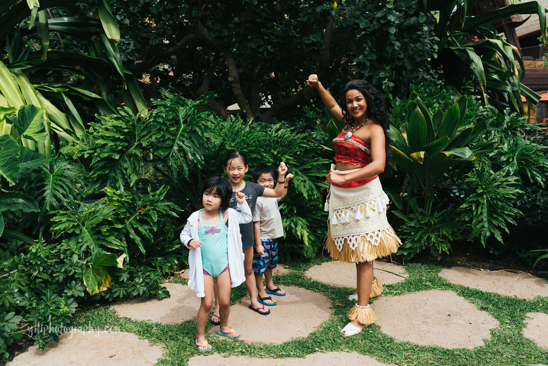 children posing with moana at aulani