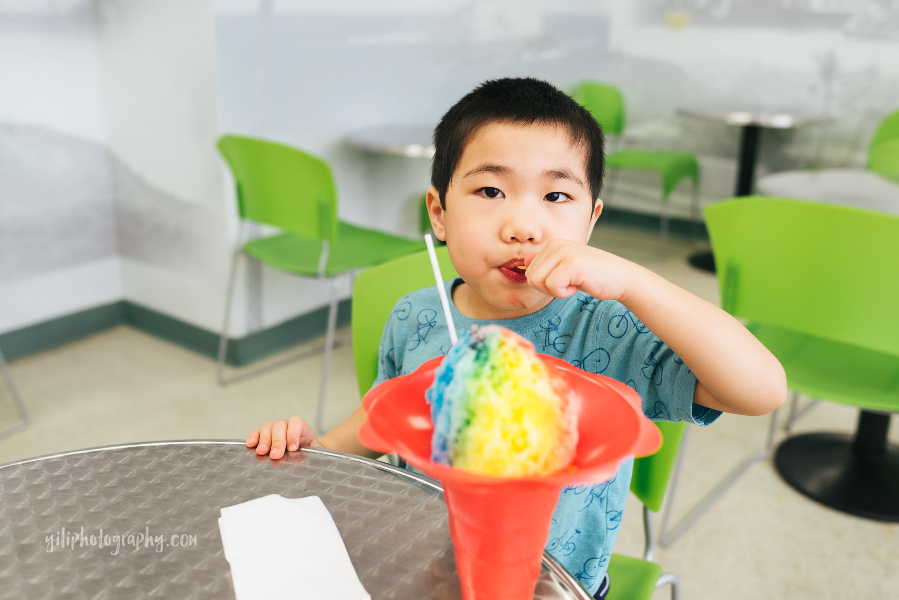 boy eating rainbow shave ice
