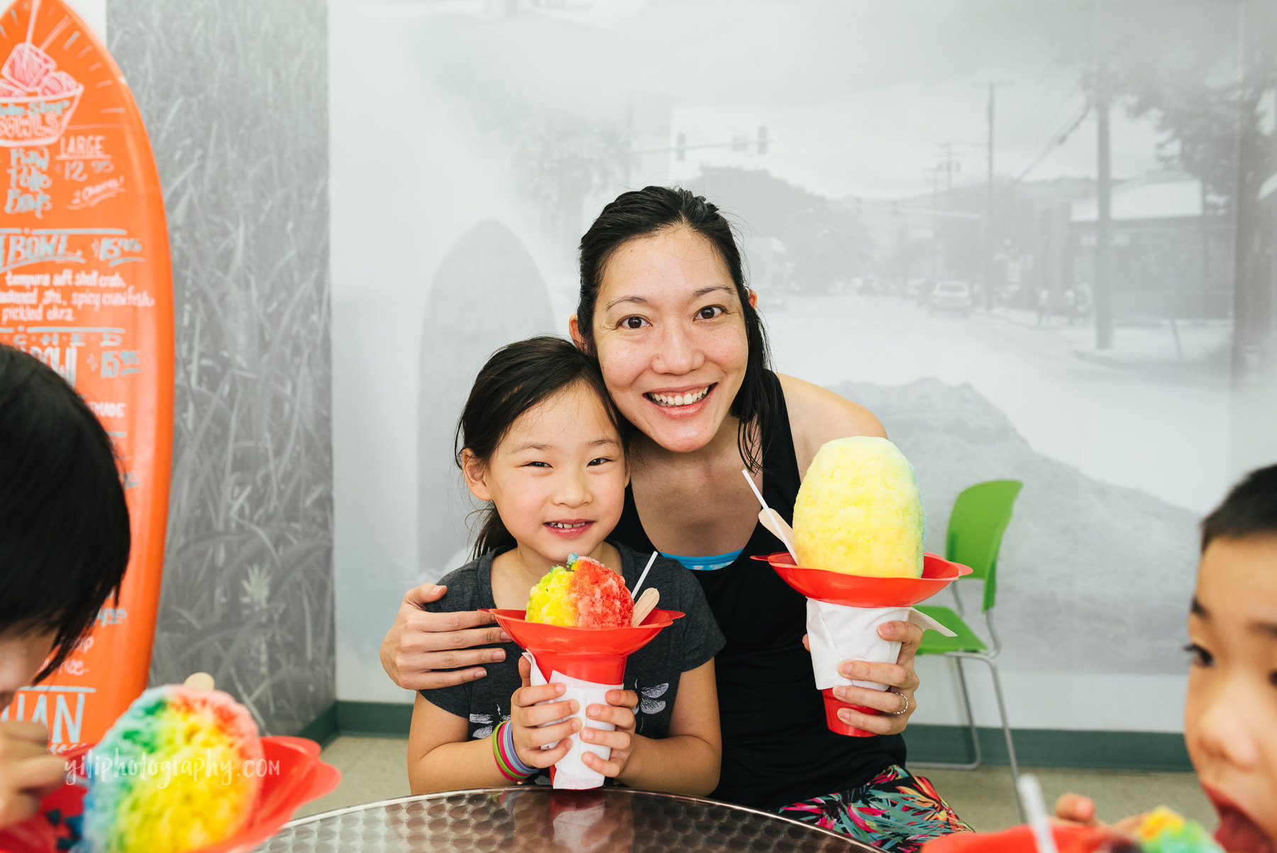 mom and daughter posing with shave ice