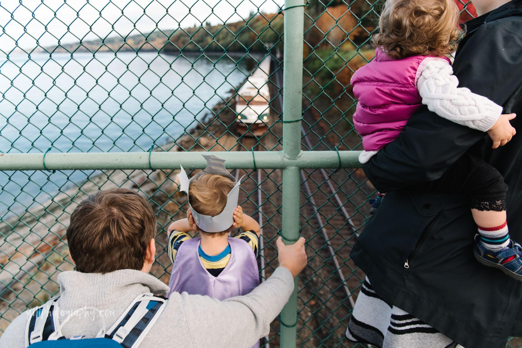 Watching trains from trestle at Carkeek Park Seattle Washington