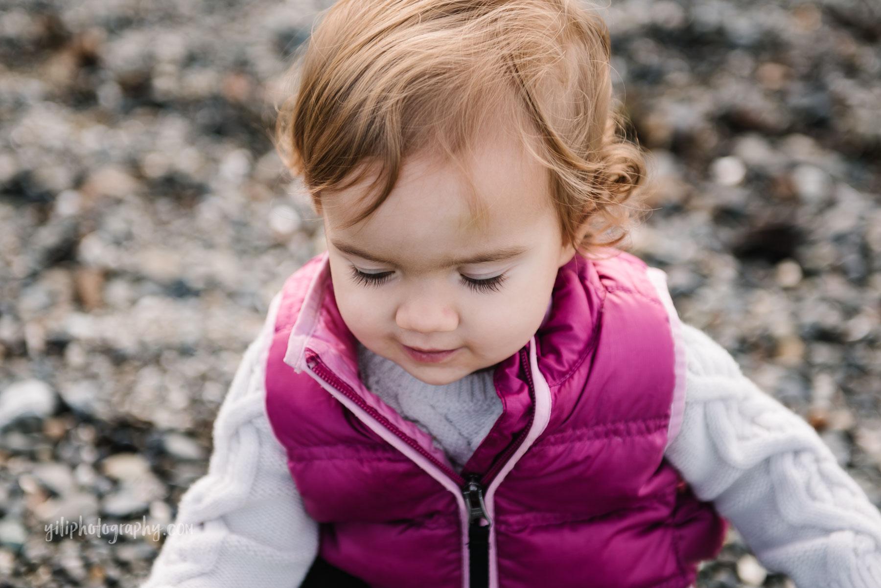 close up of toddler girl at Carkeek Beach Seattle WA