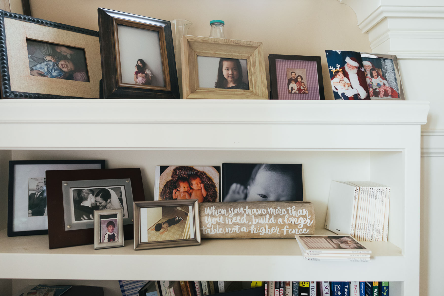 built-in bookshelf with framed photographs and photo books