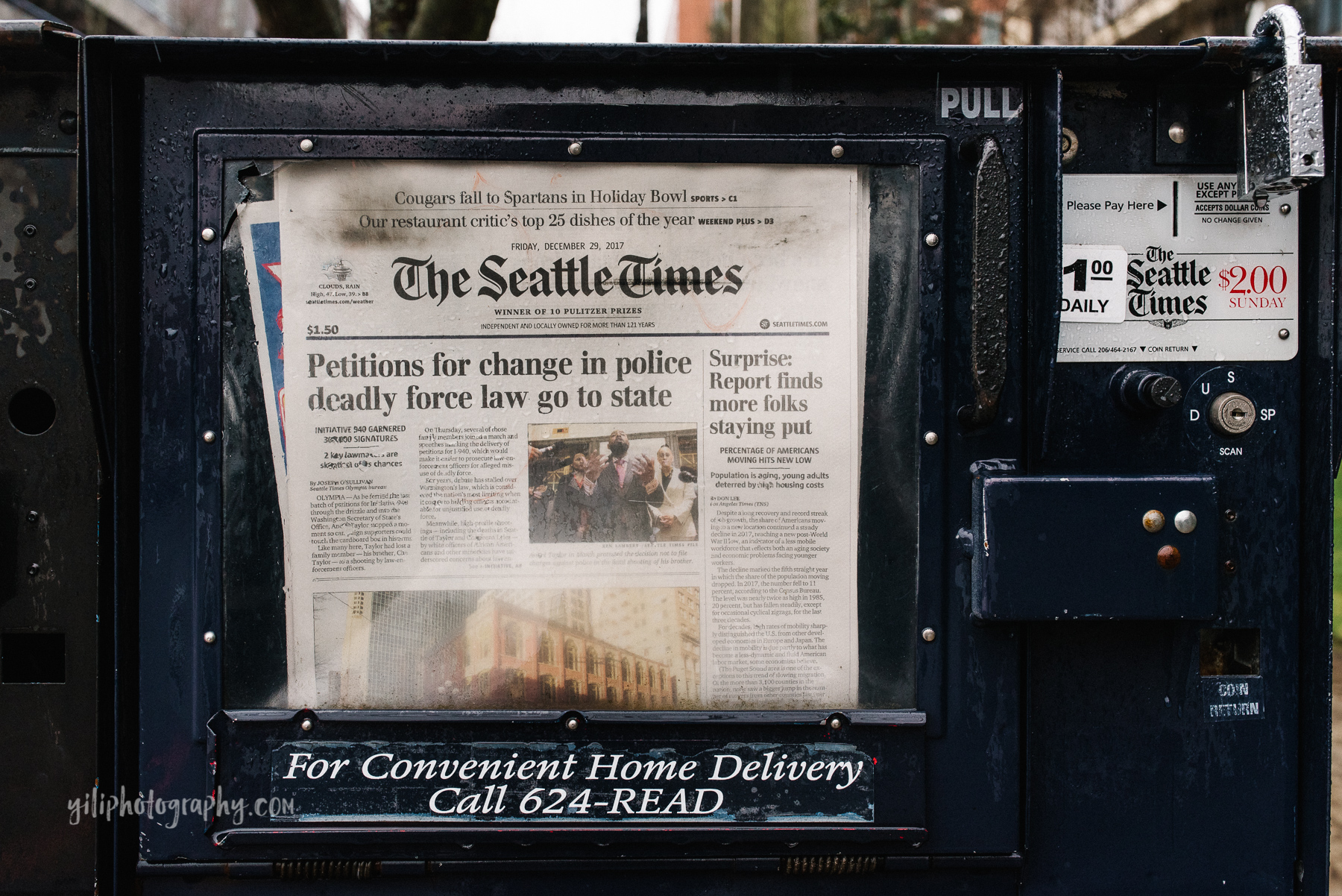 newspaper vending machine showing seattle headline