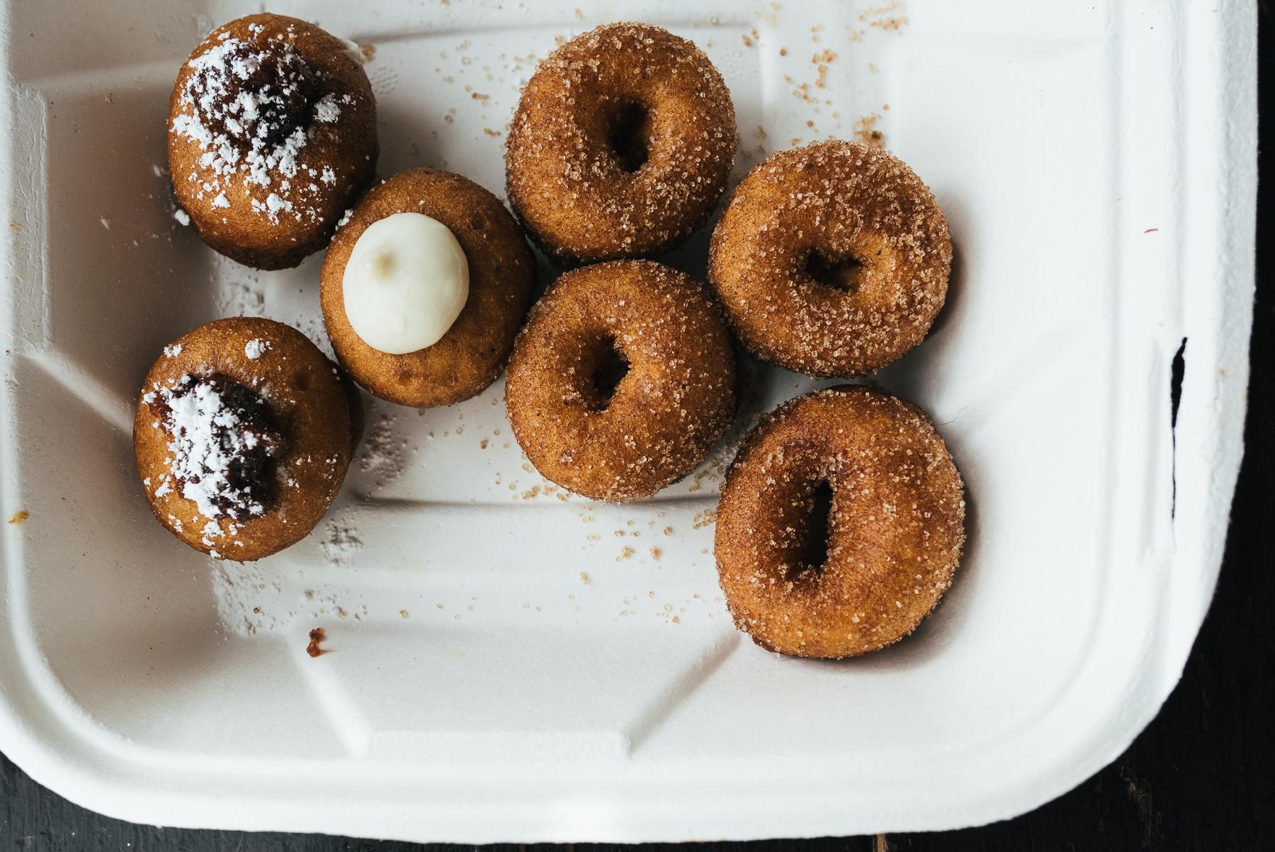 mini doughnuts in a take out box