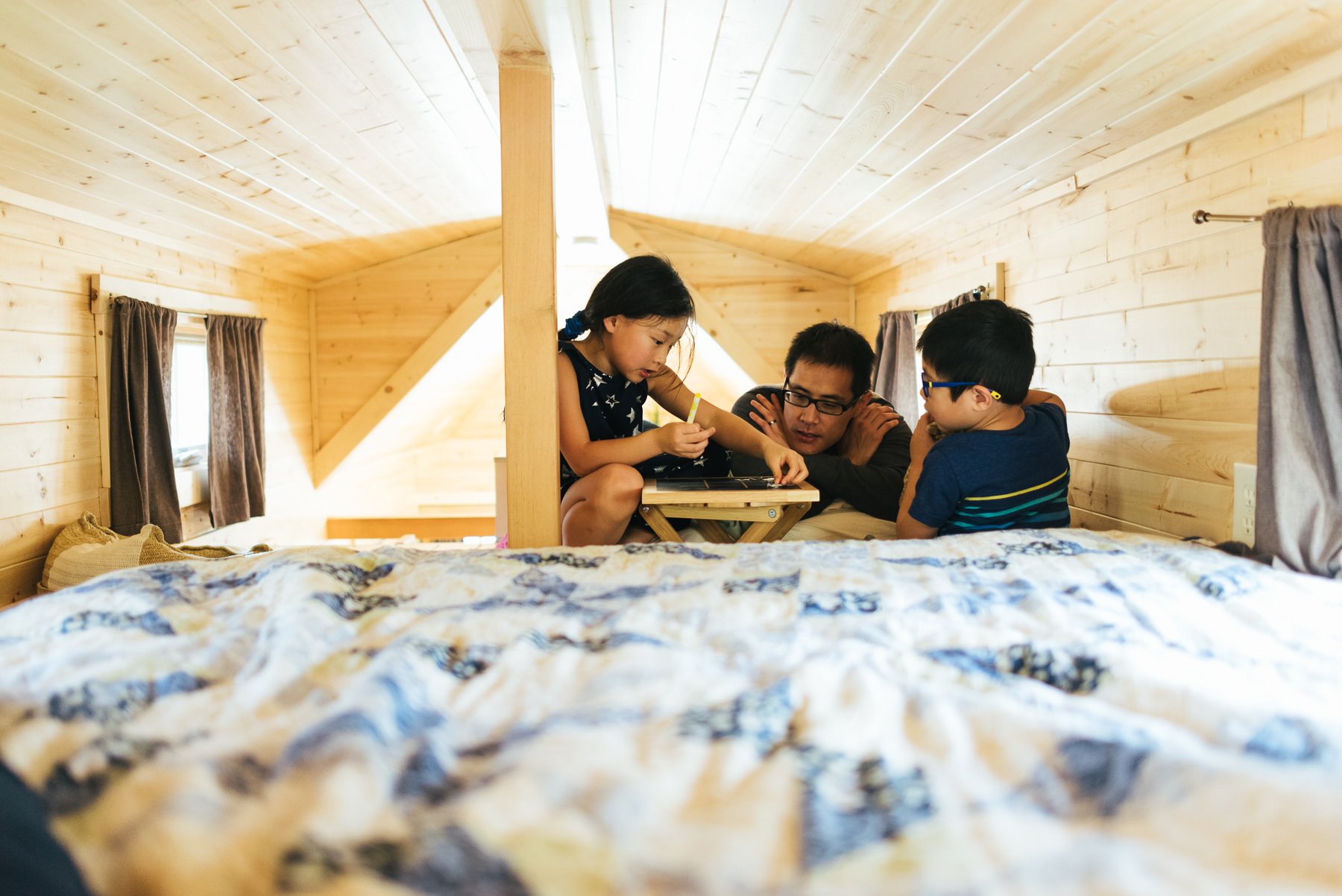 father with two kids in tiny house loft