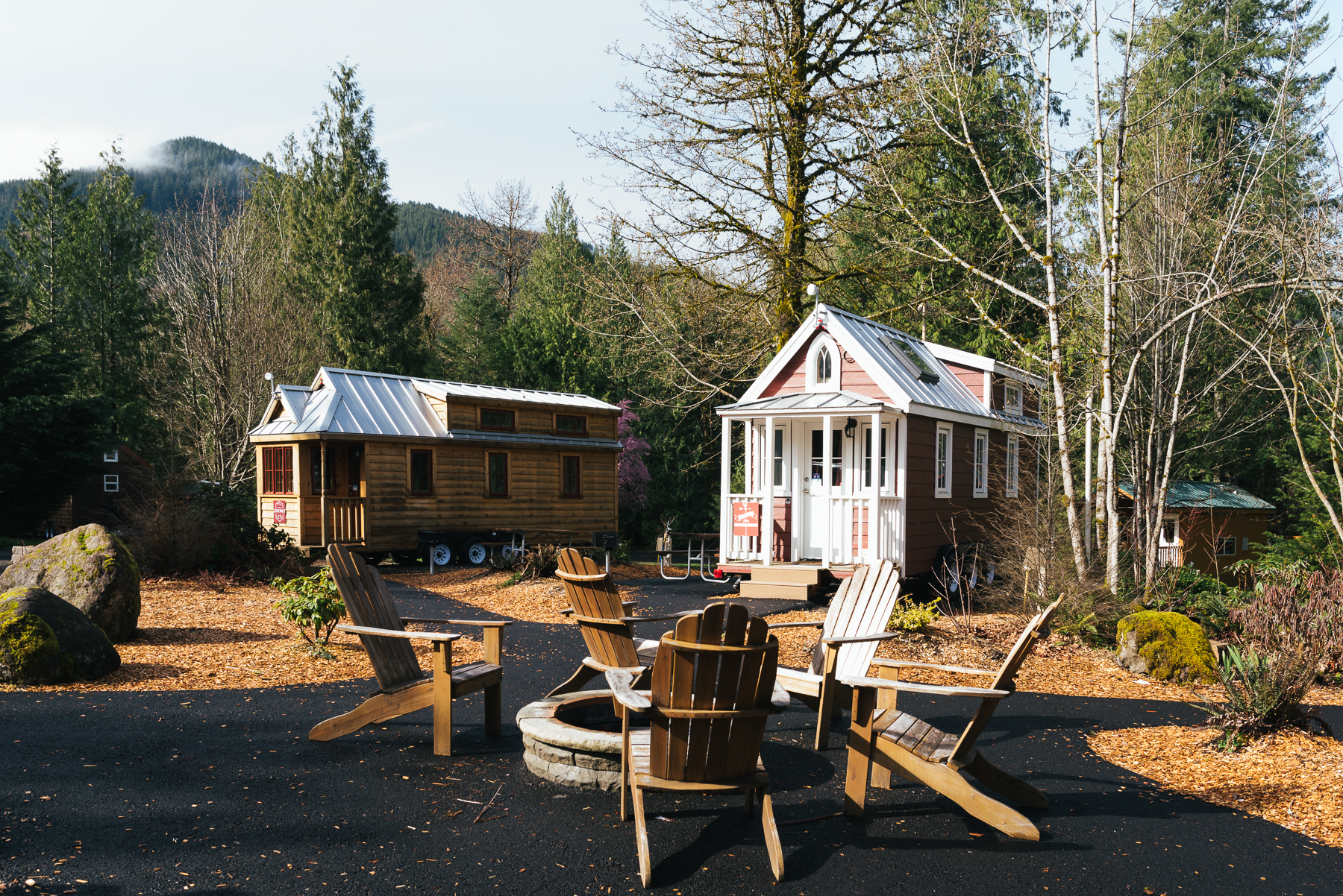 two tiny houses and firepit outdoors