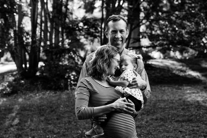 black and white maternity family portrait in seattle arboretum