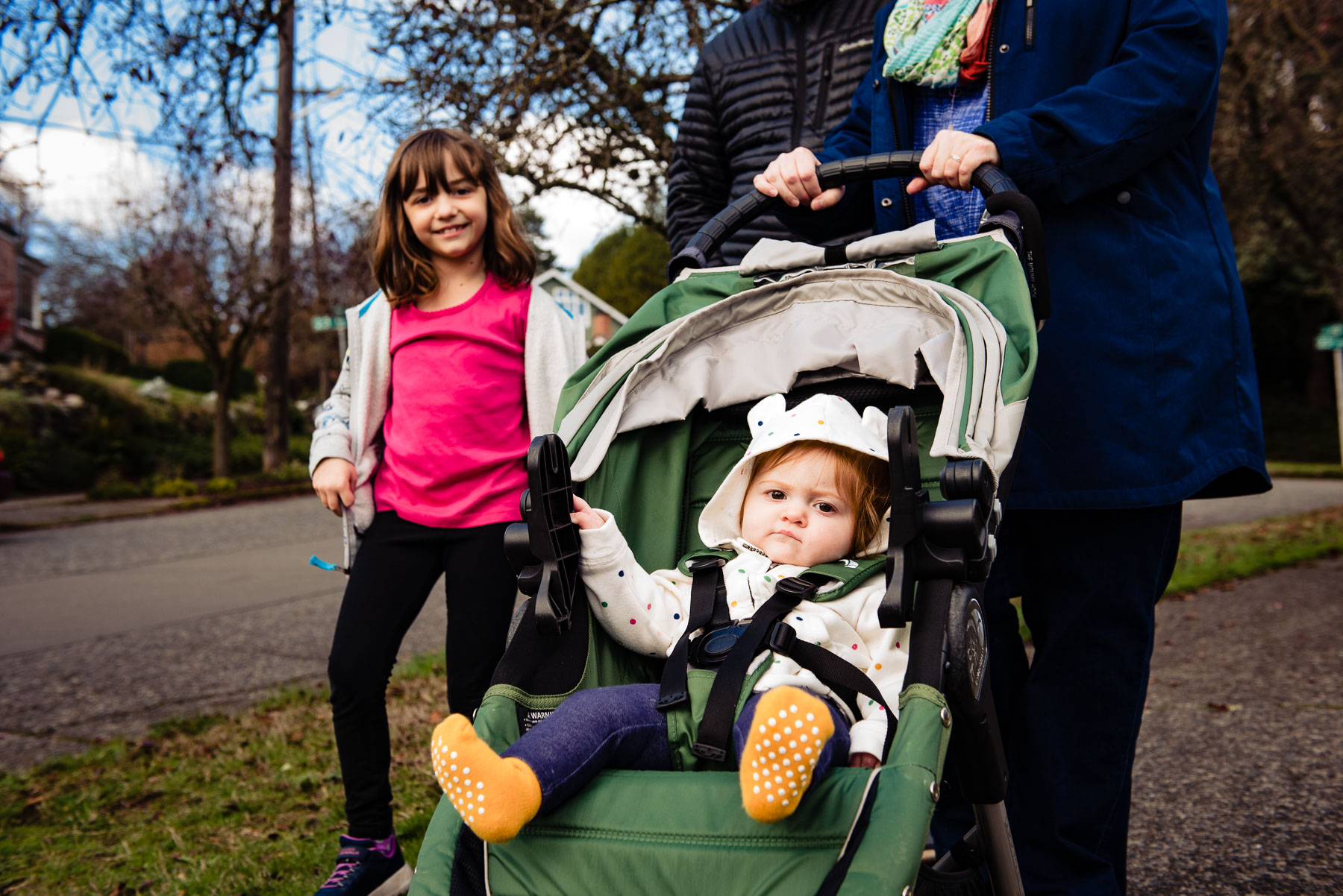 baby in stroller with sister walking