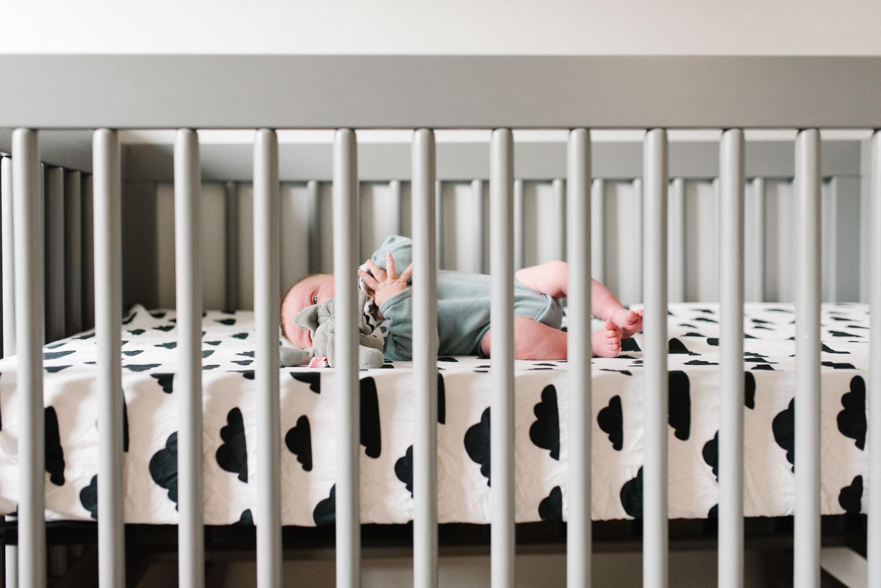 newborn baby boy in modern crib
