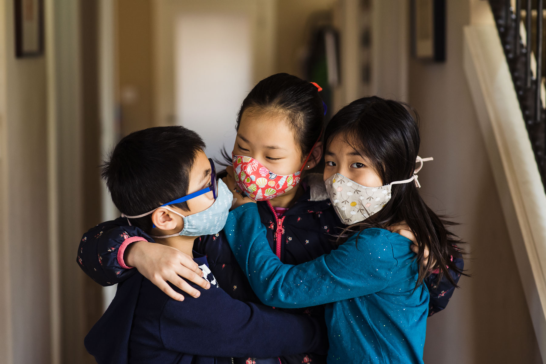 Asian siblings wearing cloth face masks
