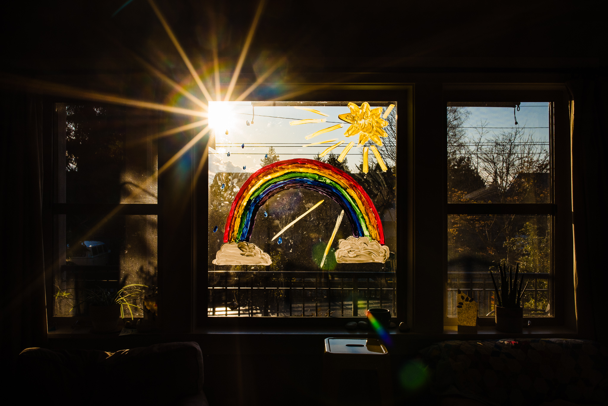 rainbow painted on window inside home