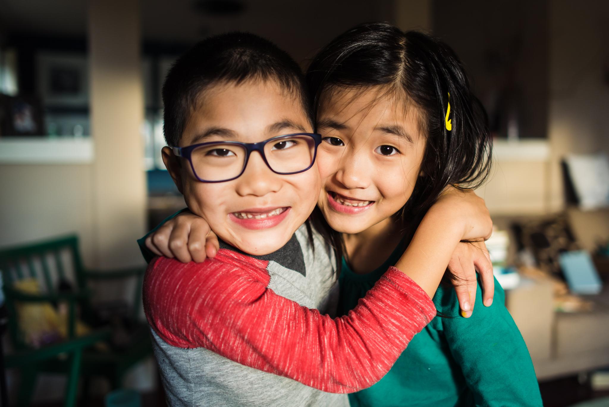 boy girl twins cuddling at home
